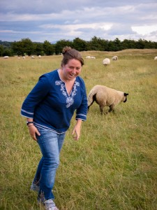 Kendra running with the sheep at the Hill of Tara in Ireland.
