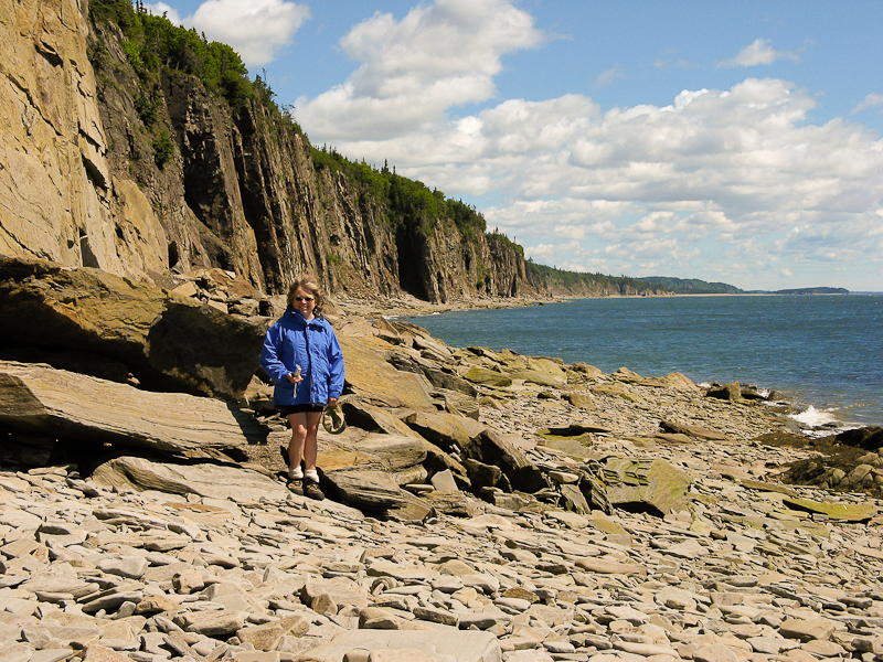 Jane on the rocky beach of Cape Enrage, New Brunswick, Canada.