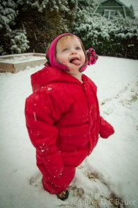 Addie catching snowflakes on her tongue.