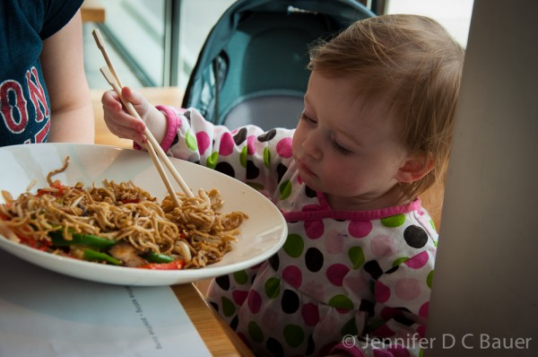 Addie eating noodles at Wagamama in London, England.