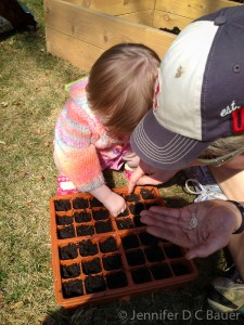 Planting seeds for our garden.