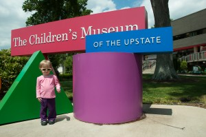 Addie outside the Children's Museum of the Upstate in Greenville, South Carolina.