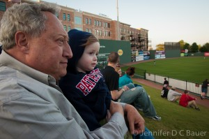 Addie and G-Dad watching the Greenville Drive.
