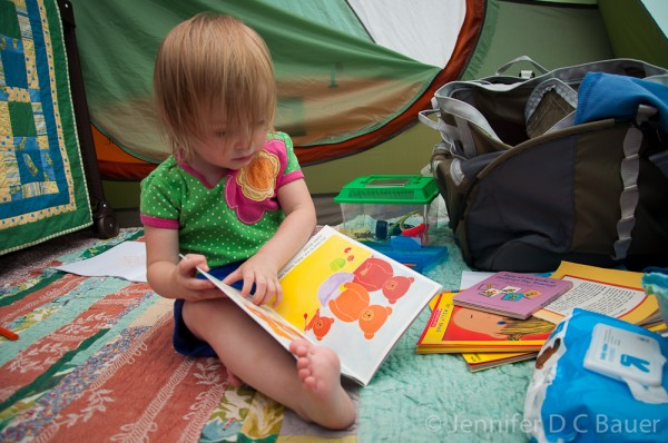 Addie reading in our tent.