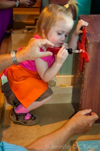 Addie learning how to use a screwdriver at the Children's Museum in Boston, MA.