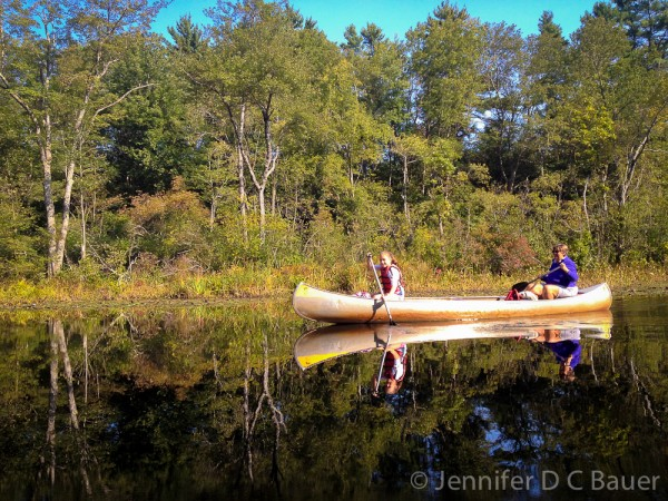 Kelly and Beth paddling down the Ipswich River.