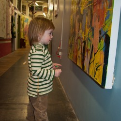 Addie checking out the art at the Western Ave Studios in Lowell, MA.