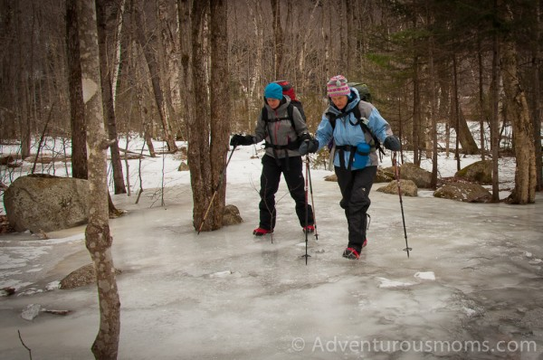Crossing over the frozen water leading to the Mt. Willard trail in Bretton Woods, NH.