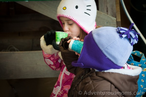 Addie and Elizabeth sampling freshly made maple syrup at Appleton Farms in Ipswich, MA