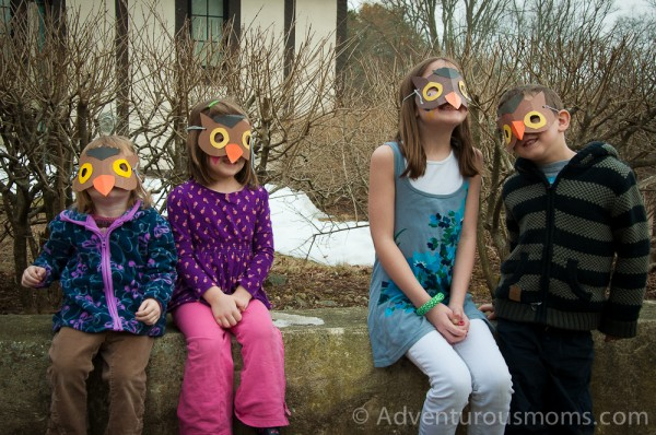 The kids showing off their owl masks!