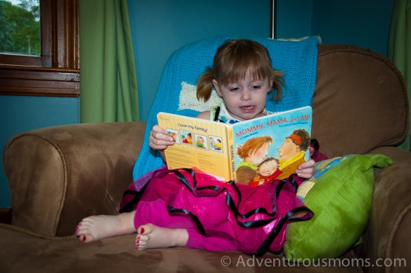 "Addie reading, ""Mommy, Mama, and Me."""