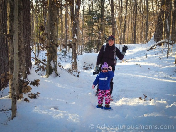 Addie and Mama snowshoeing.